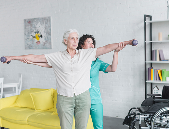 nurse-helping-her-senior-female-patient-exercising-with-dumbbells